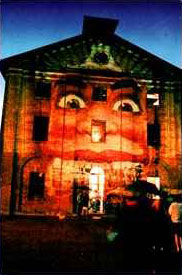The face of Luna Park projected on Hyde Park Barracks, Sydney Festival, 1993.